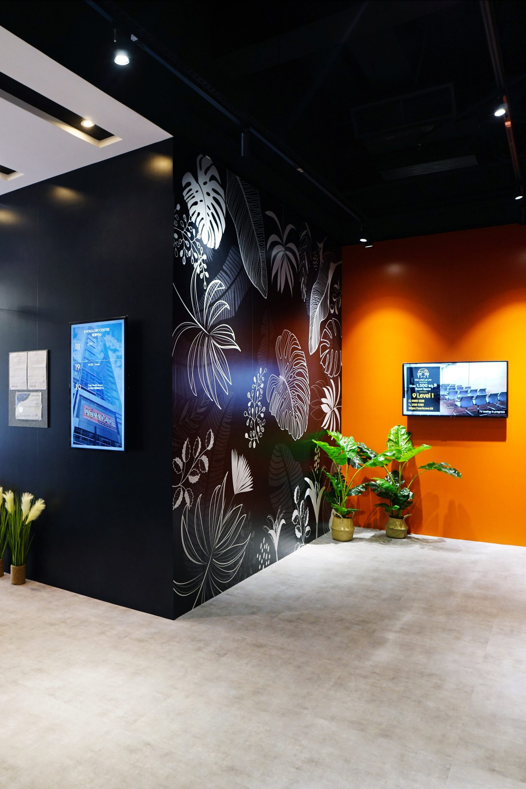 Lobby with orange wall and line art and directory board