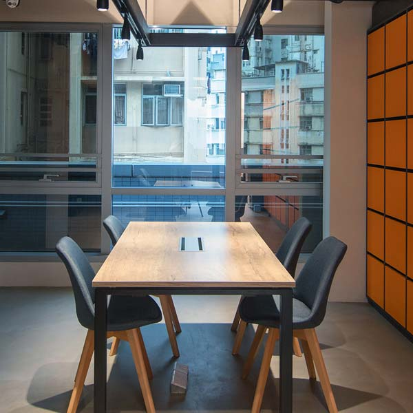 Table and chairs in coworking area - WorkCave Hong Kong