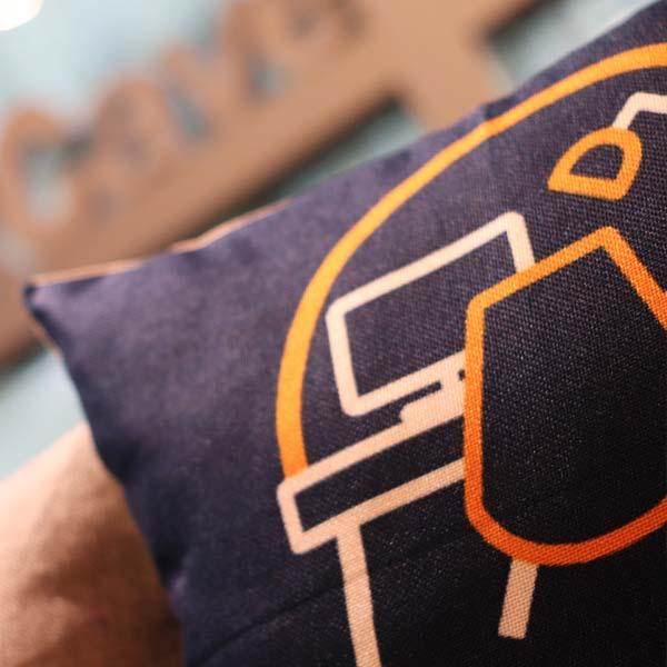 Purple cushion with WorkCave logo