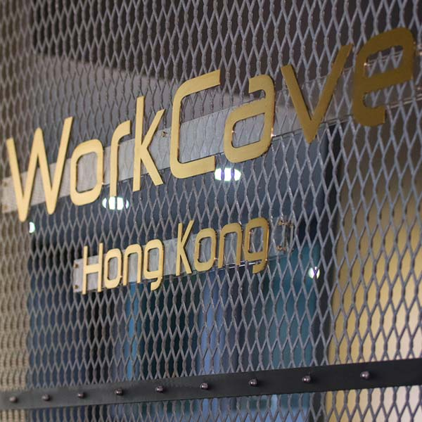 Wire fence with WorkCave logo